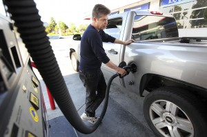 John Dato pumps gas at a 76 station in West Covina, Calif.